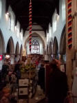 Lots of ringers treasure hunting in Halesworth church at the Guild Social.
