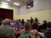 Michelle & Ed Rolph giving the answers of the quizzes & announcing the results at the Guild Social in Holton Village Hall.