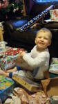 Alfie gets stuck into his presents.