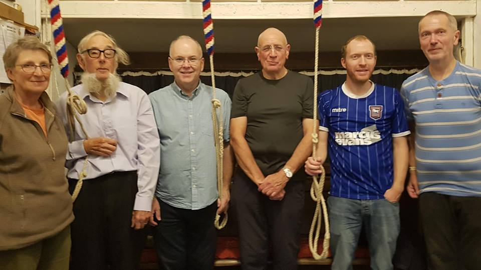 Peal band at Bredfield after the peal, with the ropes of the back three. L to r; Mary Garner, Micheal Pilgrim, Mark Ogden, Mike Cowling, Richard Munnings & Mike Whitby.