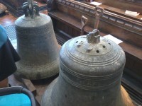 Two of the bells at on the floor of Combs church.