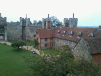 The tower of St Michael & All Angels, Framlingham - home to a 16cwt eight - pokes over the castle walls.