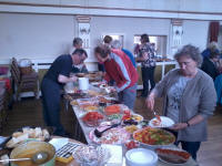 Suffolk's ringers tucking into the fantastic spread at St Edmund's Hall in Southwold.