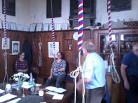 The South-East District band gathered in the ringing chamber at Southwold as they prepare to start the Rose Trophy.