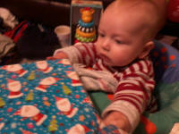 Joshua eyes his presents with suspicion.