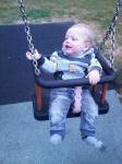 Joshua enjoying his first go on a swing!