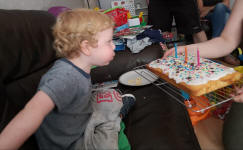 Joshua blowing out the candles on his birthday cake.