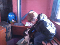 Mason with Lucy the dog in Grundisburgh ringing chamber.