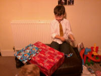 Mason opening his birthday presents.