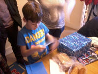 Mason opening more birthday presents!