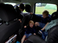 The boys 'helping' us put the tent up by staying in the car.