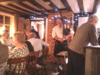 Ron plays the bagpipes at the Pettistree Ringers' Dinner.