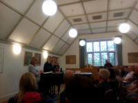 Judges Kate & Paul Flavell giving the results in the Song Room at the cathedral.