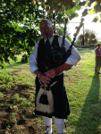 Ron playing the bagpipes in Pettistree churchyard.