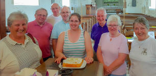 Ruthie with her cake and some of the others at Pettistree practice.