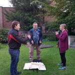 Ringing handbells in St Mary-le-Tower churchyard
