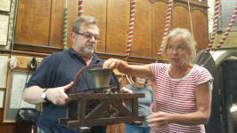 Amanda Richmond demonstrates the mechanics of ringing with the help of Jonathan Williamson at the St Mary-le-Tower Open Day.