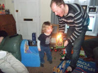 Mason blowing the candles out on his cake