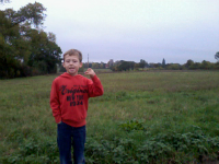 Mason on our walk, with Monewden church in the background as the quarter is being rung.