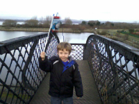 Mason with his new Thomas the Tank Engine flag on the bridge over the Bo'ness & Kinneil Railway.