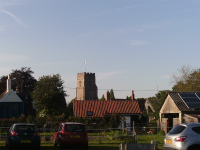 Pettistree Church In Early Summer Evening Sunshine From Across The Village.