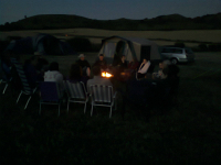 Ramblers sat round the campfire.